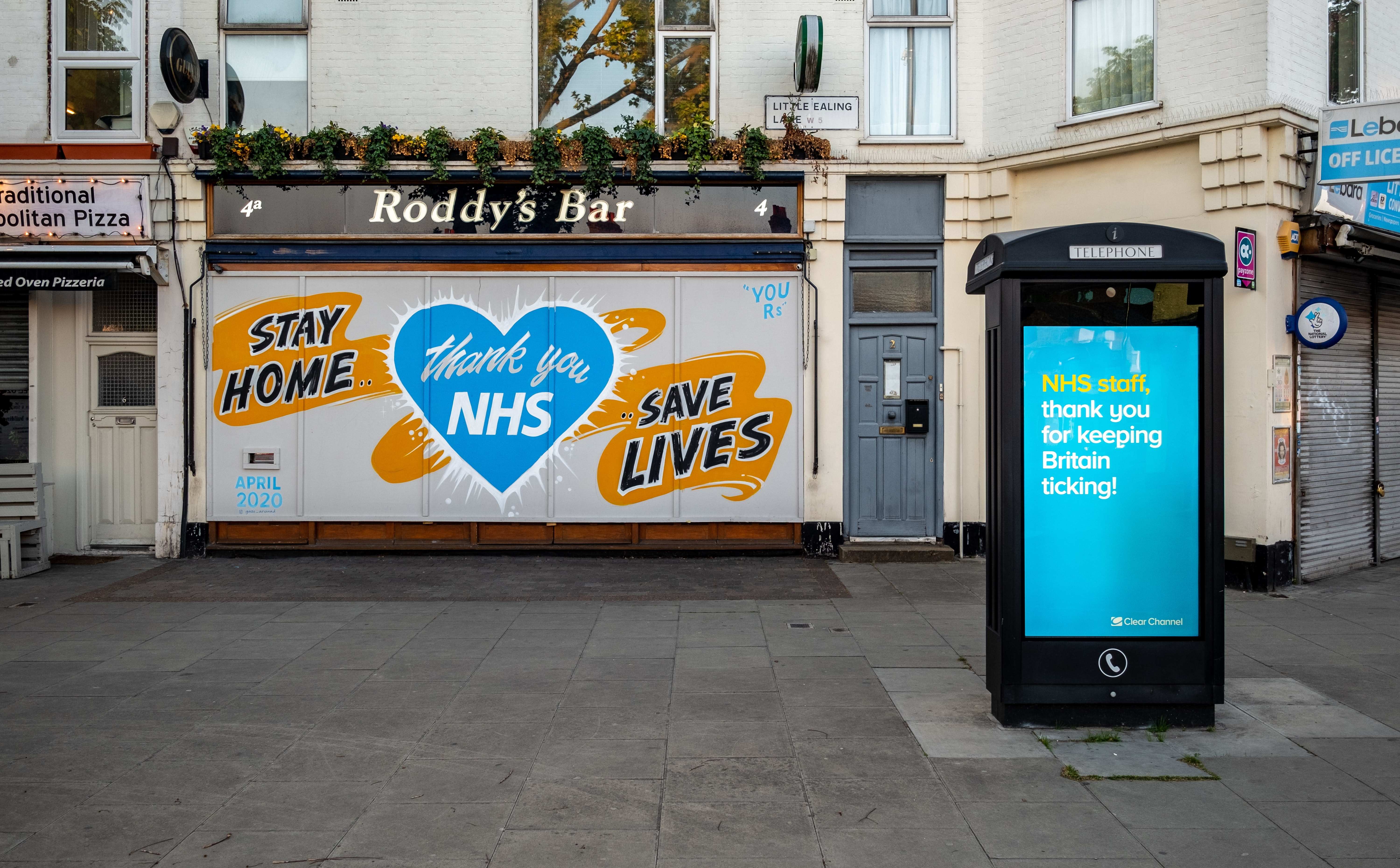 Outside of a bar sayin 'than you NHS' in a blue heart and 'stay home, save lives'